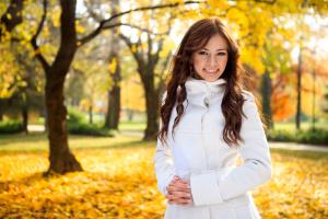 Beautiful girl in the autumn fall